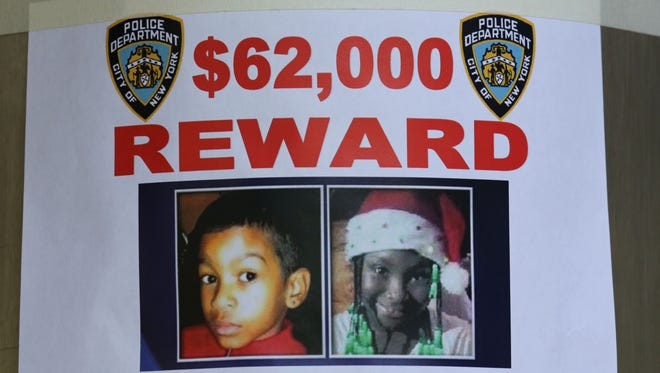 A reward poster in the stabbing case hangs at an entrance to the Boulevard Houses in Brooklyn on Wednesday.