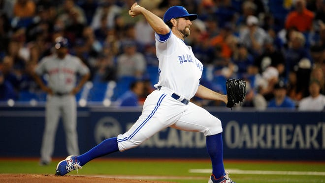 Toronto Blue Jays starting pitcher R.A. Dickey (43) pitches against the New York Mets at Rogers Centre.
