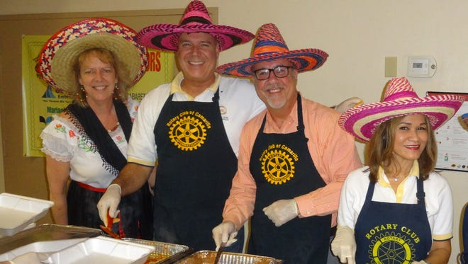 Serving at an earlier Viva La Comida are Ronda Werner (from left), Dave Drumright, Sean Walton and Lyda Sprinkles. This year's event is Tuesday.