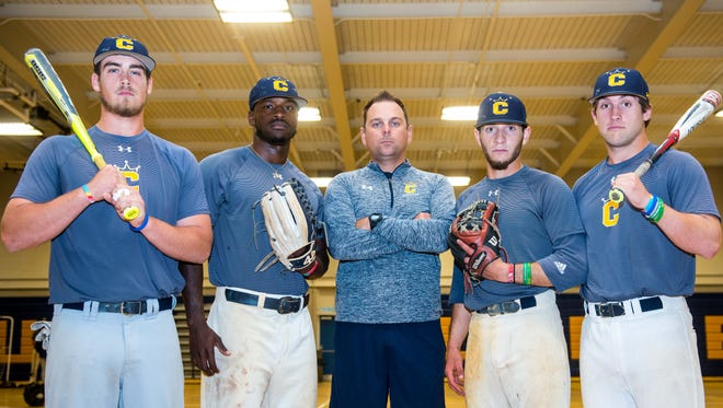 Cumberland County College's Anthony Harrold, Tovine Potts, head coach Keith Gorman, Marco Rios and Mitch Walker pose for a photo during a recent practice. The Dukes have won 33 games in a row.