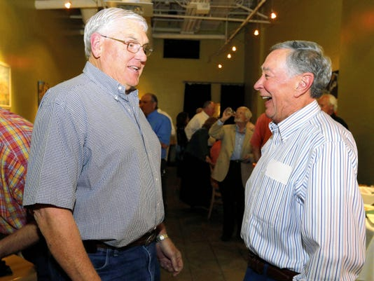 "RUBEN R RAMIREZ—EL PASO TIMES Denny Neison shares a moment with City Council District 1 candidate Albert ""Al"" Weisenberger shortly after updated numbers were released that showed him ahead in the race and putting him into a run off against Peter Svarzbein."