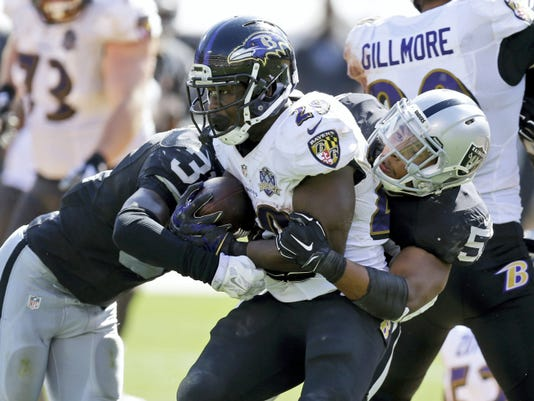 Oakland Raiders outside linebacker Malcolm Smith (53) tackles Baltimore Ravens running back Justin Forsett (29) during the second half Sunday in Oakland, California.