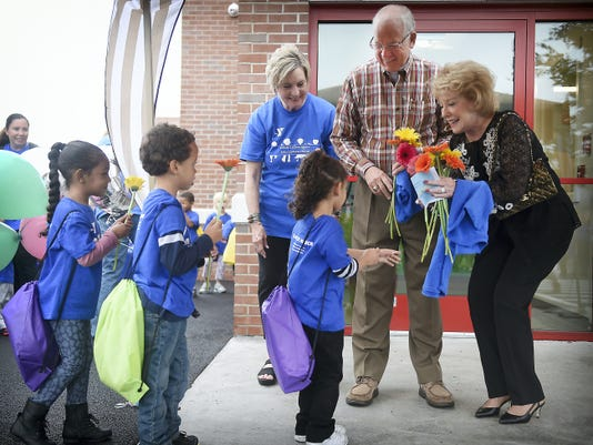 Jeanne and Edward Arnold receive flowers Wednesday from a class of 4-year-old children who will attend the new Lebanon Valley Family YMCA Edward & Jeanne Arnold Early Learning Center. The center officially opened on Wednesday. The Arnolds, well-known Lebanon Valley philanthropists, donated 500,0000 towards the million-dollar project.