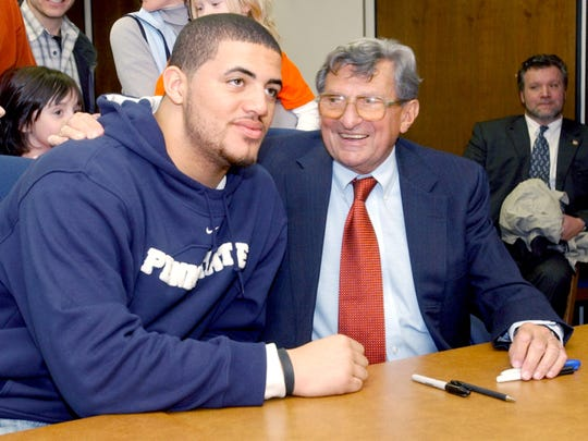 Penn State football coach Joe Paterno chats with Lebanon High School recruit Jared Odrick during a visit to Lebanon in 2006. Odrick, a 285-pound defensive tackle, played in the Big 33 before earning Big Ten Defensive Player of the Year honors at Penn State. Odrick signed to play with the Jacksonville Jaguars this season.