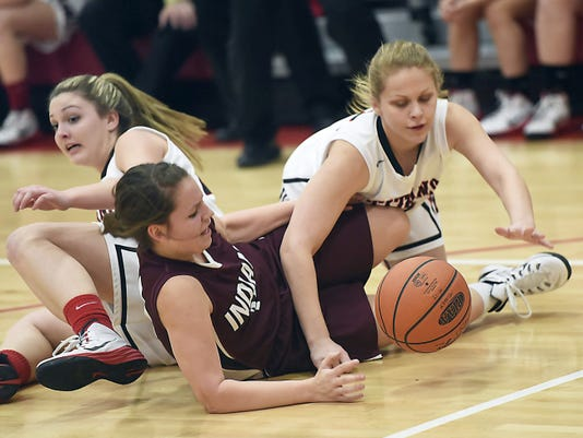 Southern Fulton's Lakyn Morton (10) goes to the floor for a loose ball against Alex Watkins (11) of Tussey Mountain during the District 5-A semifinal girls game on Thursday. The Indians scored just 13 points in the first half and lost 54-47.