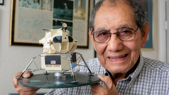 David Adan, who worked on the 1970 Apollo 13 space mission, holds a model of the lunar module inside his home in Palm Beach Gardens.