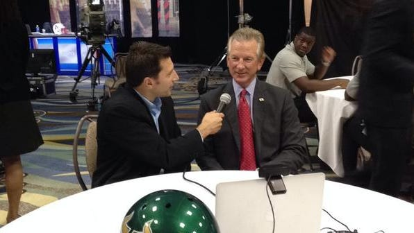 UC head coach Tommy Tuberville makes the rounds at AAC media day.