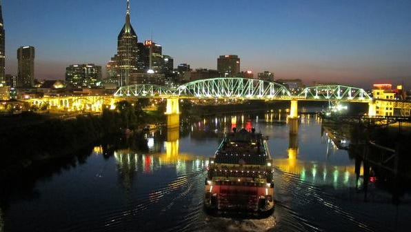 The General Jackson approaches the John Seigenthaler Pedestrian Bridge in downtown Nashville, where the economy is booming.