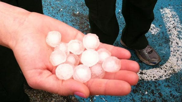 Rain and hail fell on parts of Washington Wednesday, helping firefighters battling the Carlton Complex Fire.