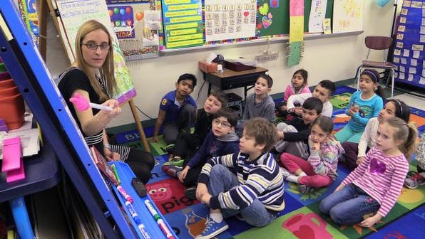 Student teacher Samantha Felder works Thursday with first-graders at the Park Avenue School in Port Chester. She is completing a master's degree at Manhattanville College and is preparing for a new exam in order to get her initial certification to teach in New York State.