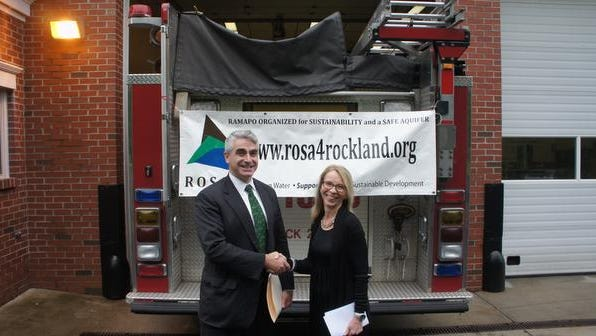 Attorney Daniel Richmond and ROSA Director Suzanne Mitchell outside the Hillcrest Firehouse,  celebrating a judge's decision  about Ramapo's Patrick Farm.