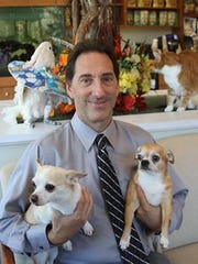 Dr. Paul Sedlacek, veterinarian, with two of his clients