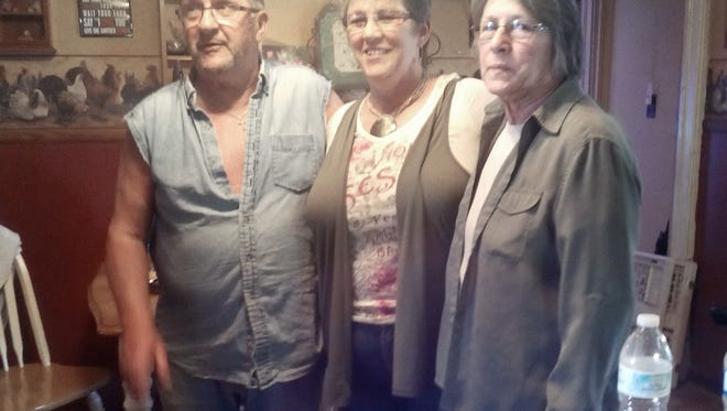 At the age of 51, Gwen Miller, center, of Strasburg, has finally met both of her parents, Kenny Zimmerman, left, of Coshocton, and Pat Roup, right, of Uhrichsville.