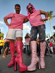 Blake Crawford and Lawrence Perillo sported the most outrageous footgear on the street in this file photo of one of the  Stiletto Sprint races in downtown Naples.