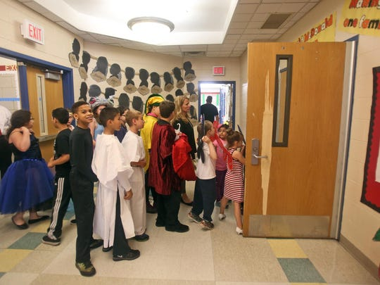 """Students line up to enter the auditorium for their dress rehearsal of """"A Midsummer Night's Dream"""" at Paideia School 15."""