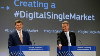 Vice President for the Digital Single Market of the European Commission Andrus Ansip, left, and EU Commissioner for the Digital Economy and Society Guenther Oettinger give a press conference on Digital Single Market Strategy at the European Commission headquarters in Brussels on May 6, 2015.