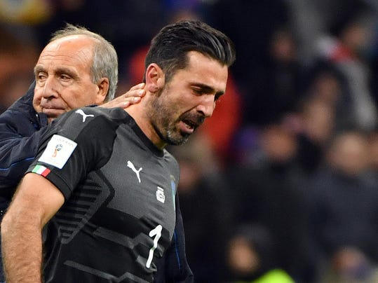 Italy coach Gian Piero Ventura, left, consoles Gianluigi Buffon at the end of the World Cup qualifying play-off return leg soccer match between Italy and Sweden, at the San Siro stadium in Milan, Italy, Monday, Nov. 13, 2017. Four-time champion Italy has failed to qualify for World Cup; Sweden advances with 1-0 aggregate win in playoff. (Daniel Dal Zennaro/ANSA via AP)