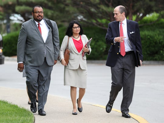 U of L Pres. Neeli Bendapudi, center, walks out of the University Club building following a meeting that led to an agreement to settle with former athletic director Tom Jurich. May 18, 2018