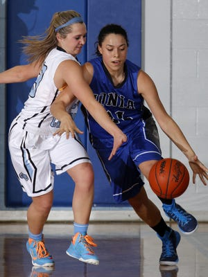 Ionia's Jaylynn Williams, right, is on the cusp of becoming just the eight player in program history to score 1,000 career points.