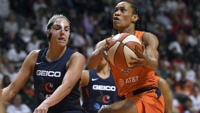 Connecticut Sun's Jasmine Thomas, right, drives against Washington Mystics' Elena Delle Donne during Game 3 of the 2019 WNBA Finals in Uncasville.