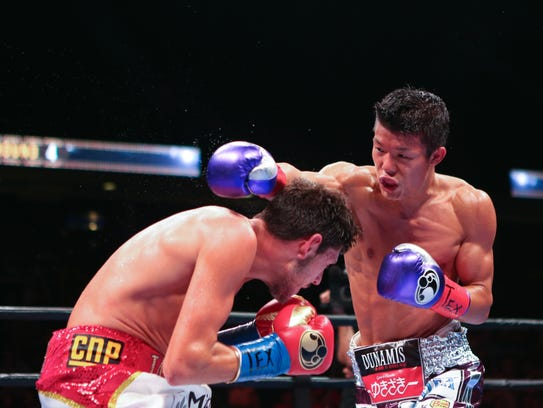 Jamie McDonnell slips a hard right from Tomoki Kameda