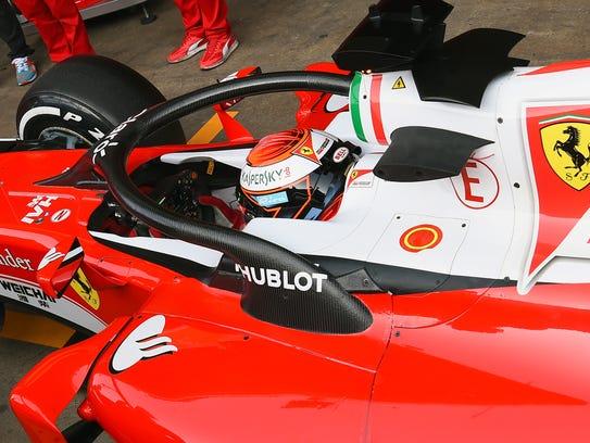 Kimi Raikkonen returns to the garage after testing