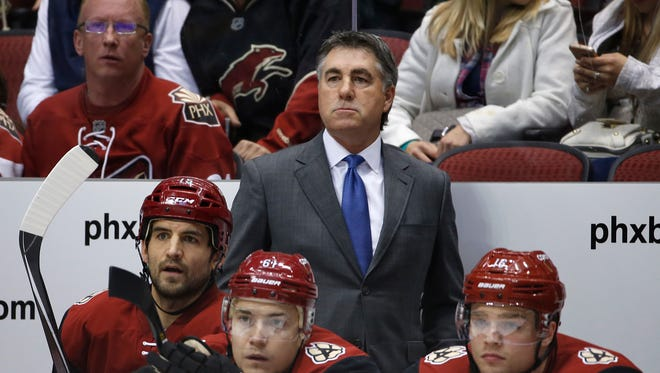 Coyotes head coach Dave Tippett watches over his team as they play the Stars at Gila River Arena in Glendale, Ariz. on Thursday, March 24, 2016.