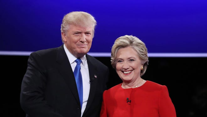 Donald Trump and Hillary Clinton shake hands at the start of their first debate, at Hofstra University in Hempstead, N.Y.