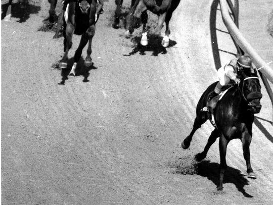 Spend A Buck pulls away in the 1985 Kentucky Derby,