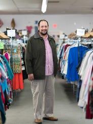 Shawn Keyer inside of the Family Promise Thrift Store