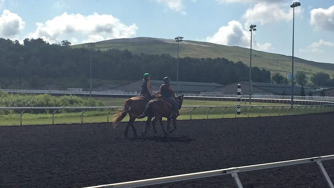 Riders work out horses Friday at Presque Isle Downs & Casino in Summit Township in preparation for the 2020 meet that starts Monday.