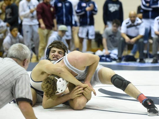 Piedra Vista's Nick Rino, top, wrestles in the finals of the Panther Classic against Cleveland on Dec. 19 at the Jerry A. Conner Fieldhouse in Farmington.