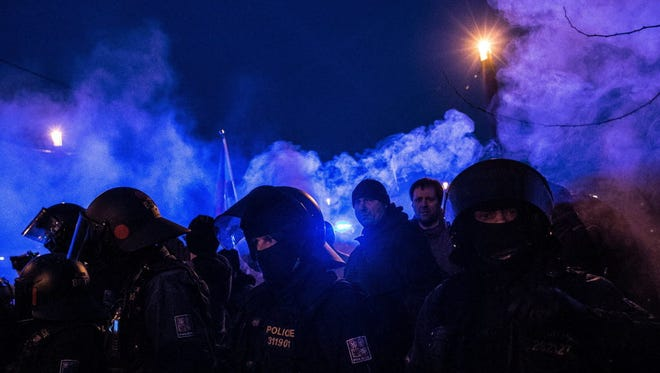 Far-right protesters clash with riot police during an anti-Islam rally in Prague, Czech Republic, on Feb. 6.