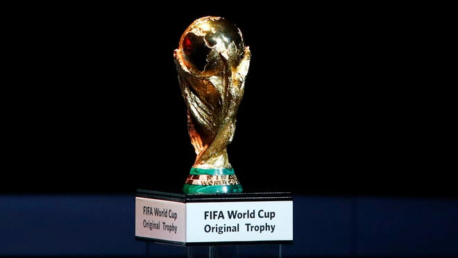 Tthe World Cup trophy is placed on display during the 2018 World Cup draw in the Kremlin in Moscow.