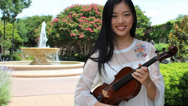 "Feisi ""Faith"" Fang, a junior at ATEMS, is an accomplished violinist, started instruction when she was 5."