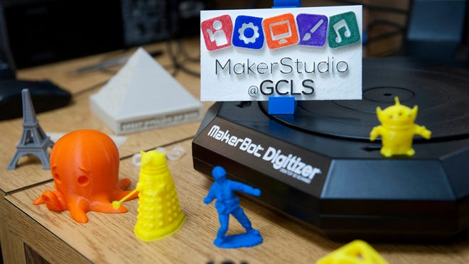 Figures made with the library's new 3D printer sit scattered on the desk in the MakerStudio at the Gloucester County Library System's Mullica Hill Branch on Thursday, May 29, 2014.