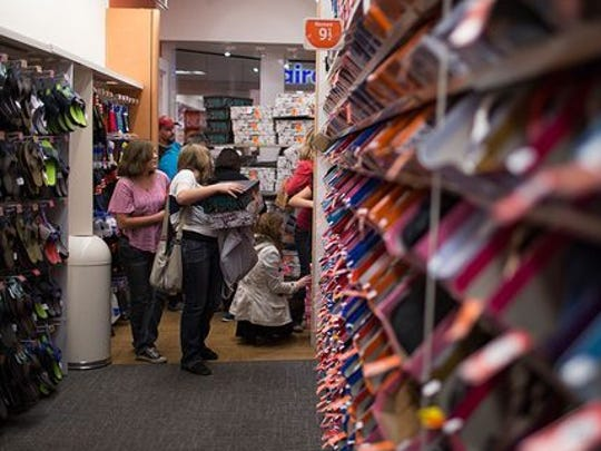 Customers at a Payless store.