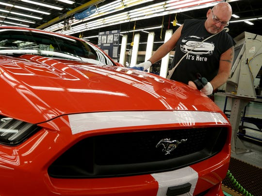 Wayne Moshier, 57, of Temperance, shines and buffs a 2015 Ford Mustang on the assembly line inside the Ford Motor Company Flat Rock Assembly Plant in Flat Rock on Thursday, Aug. 28, 2014.