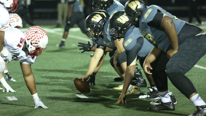 Warren Central prepares to snap the ball against Center Grove Friday November 6, 2015 during the 6A Regionals at Warren Central.