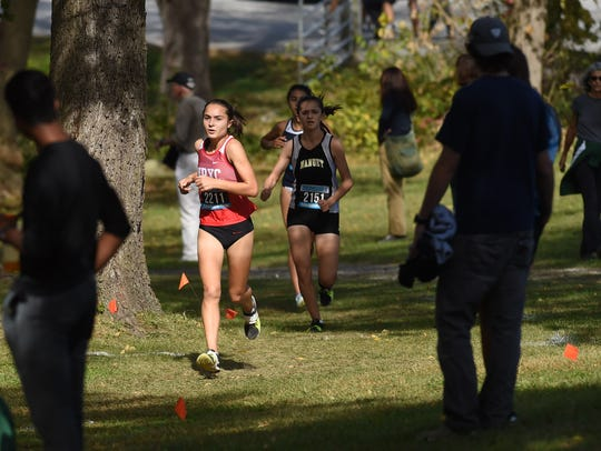 North Rockland's Catherine Ruffino, center, heads into