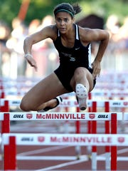 West Salem's Keira McCarrell competes in the finals of the girls 100 meter hurdles at the Greater Valley Conference District Championships track and field meet at McMinnville High School on Friday, May 13, 2016. McCarrell placed first.