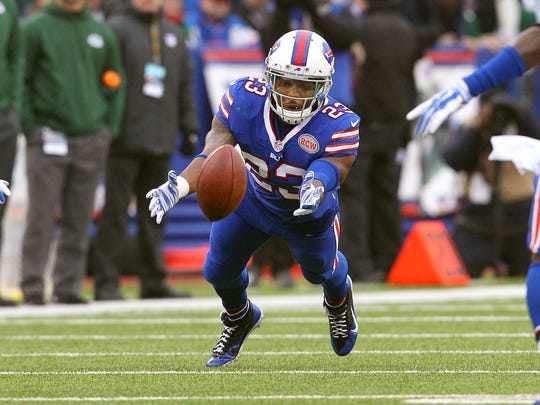 Bills safety Aaron Williams (23) dives to a tipped