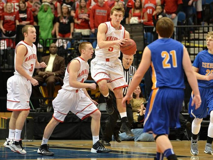 Annandale's Matt Mille (5) grabs a rebound from a failed shot attempt by Esko during the first half of the Class 2A boys' state basketball tournament championship game Saturday afternoon at the Target Center in Minneapolis. Esko led the Cardinals 22-18 at halftime.
