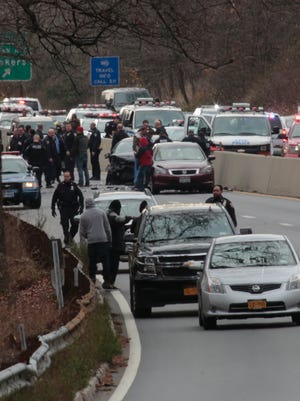 A car chase involving police from the NYPD which started in Manhattan ended on the northbound lane in Yonkers with one suspect fatally shot and the other in custody on Dec. 8, 2015.