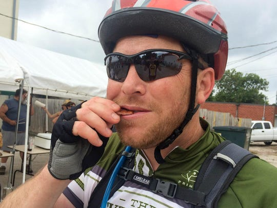 Bernie Bockelmann, 42, of Omaha eats a piece of bacon during the Bacoon Ride in Redfield in June 2014.