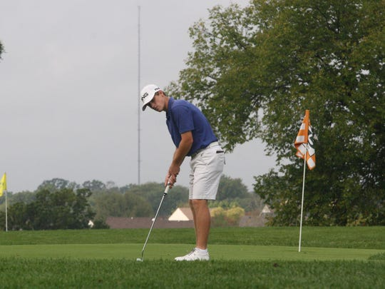 St. Xavier's Cameron Frazier gets some work in on the practice green before his round Oct. 12, 2017 at the Division I district tournament at Glenview Golf Course.
