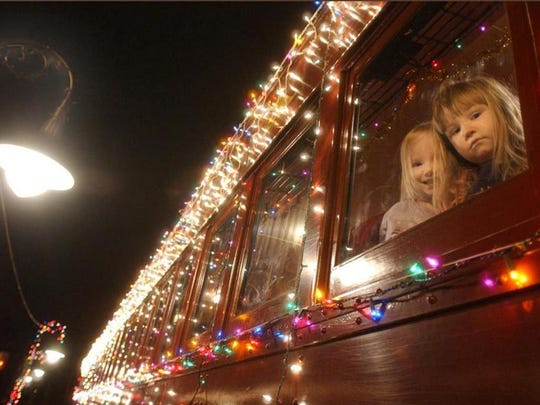 Alorra Wynter (left) and Nicole Young, both 3, of Cecilton, Maryland, settle into The Paul Revere doodlebug train before the start of a  Holiday Nights Express ride on the Wilmington and Western Railroad, Wednesday, Dec. 29, 2004 at the railroad's station near Prices Corner. The News Journal/William Bretzger