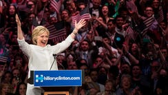 Clinton gestures to the crowd at the start of her remarks