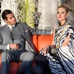 """Henry Cavill, left, as Napoleon Solo, and Elizabeth Debicki as Victoria appear in """"The Man from U.N.C.L.E."""""""