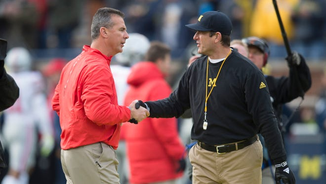 Urban Meyer and Jim Harbaugh shake hands before last year's game in Ann Arbor.